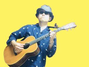 ダリーウメモのギター姿